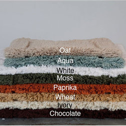 None - 100-percent Egyptian Cotton Plush No-slip 24 x 34 Bath Rug - Update your bathroom decor with this plush bath mat for a luxurious feel. Non-slip coating on the bottom of the rug prevents bunching or sliding. The cotton rug is machine washable for easy cleaning,and is available in eight color options.