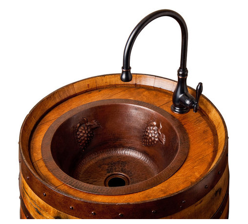 Alpine Wine Design - Wine Barrel Bar Sink - Building your dream wine bar? Well, here's the perfect cask to perform your wet tasks. The base is crafted from a reclaimed wine barrel and topped with a deep, grape-embossed copper sink and coordinating faucet for a look you'll pop a cork over. Made to order.