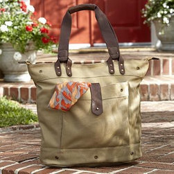 """Waxed Canvas & Leather Tote - Made of cotton canvas with genuine leather straps and a striped lining, this tote allows you to travel light and in style. Two large pockets, one inside and one outside, allow you to keep your most essential items neatly organized. 20"""" wide x 9.5"""" deep x 15"""" high Made of 16-ounce cotton canvas with PVC coating. Twill cotton lining, leather straps and brass-finished zippers. One exterior pocket and one interior pocket. Monogramming is available for an additional charge. Catalog / Internet Only."""