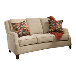 Chelsea Home - Russell Apartment Sofa - Includes two 18 in. accent pillows. Patented seating unit equal to frame within a frame construction. Kiln-dried fortress frame construction. Seating comfort: Medium. Dark trap legs provides extra durability. 0.88 in. hardwood arms are attached. Insulated power fasteners and covered. Heavyweight cardboard to shape curves. No seat cushion attached. Seat back cushion is attached. Seat cushion is reversible. Heavy duty sinuous back springs spaced closely together for maximum back support and comfort. Heavier gauge coils around the perimeter of the drop in coil unit for support and balanced seating. Machine tied drop in coil unit. Constructed of pocketed coils to provide support. 2.0 HD high resiliency foam. Sewn in channels for maximum shape retention and support. Made from polyester and solid kiln-dried hardwood. Maniac sand and maverick hazelnut color. Made in USA. No assembly required. Seat height: 20 in.. Seat depth: 20 in.. Seat width: 59 in.. Overall: 69 in. L x 37 in. W x 42 in. H (130 lbs.)
