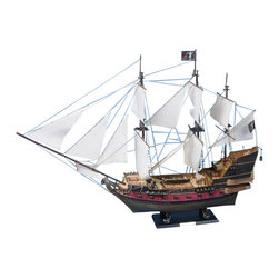 Handcrafted Nautical Decor - Blackbeard's Queen Anne's Revenge 36'' - White Sails - SOLD FULLY ASSEMBLED--Ready for Immediate Display - Not a Model Ship kit��--Brought to the silver screen in   Disney�s Pirates of the Caribbean: On Stranger Tides, the legendary   Queen Anne's Revenge has been stunningly recreated in this fabulous   model ship. In the movie Johnny Depp returns as Captain Jack Sparrow and   crosses paths with the infamous pirate Blackbeard (Ian McShane),   dreaded captain of the Queen Anne's Revenge, while searching for the   fabled Fountain of Youth. ----Set sail for adventure on the high   seas as you search for lost treasure aboard this scale tall model ship   replica of a Blackbeard�s feared pirate ship, the Queen Anne�s   Revenge 36''�- White Sails.�Fine craftsmanship and attention to detail highlight this   exquisitely constructed tall sailing pirate ship.�Whether seated upon a   shelf, desk, or table, proudly display this Queen Anne�s Revenge pirate   ship model and enjoy its indomitable spirit of adventure!�----�----    Handcrafted by our master artisans--    Individual wooden planks used      in hull construction--    High quality woods include cherry,      birch, maple and rosewood--    Extensive rigging features over 100      blocks and deadeyes--    Gun ports actually cut into      the hull--    Amazing Details, including:--    --        Planked deck with       nail holes--        Authentic scale       lifeboat with oars--        Rudder chains,       metal anchors, cannonball racks--        Fine-crafted       embellishments carved on the stern--        Additional deck       details such as cannon balls, barrels, ladders and other nautical items--        11 masterfully       stitched white canvas sails hold shape and do not wrinkle --        Taut rigging with       varied thread gauge and color--    --    --    Meticulous painting accurately matches      the real Queen Anne�s Revenge--    --        Wooden display       base--    --    --   