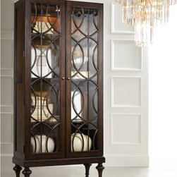 "Hooker Furniture - Melange Adaira Display Cabinet - Elegance and symmetry reach a new level of sophistication in the Adaira Display Cabinet featuring delicate wood trim on its glass doors.  Two wood-framed glass doors, one wood shelf with glass insert, one adjustable shelf, one fixed shelf, one can light.  Shelves are 35 1/2"" w x 14 1/2"" d"