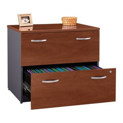 "Bush - Series C: Lateral File - Series C delivers intelligent and flexible workplace solutions for the private office environment. Thirty-two pieces meet any work or storage challenge. Intelligent design and years of refinement become apparent the moment the office is planned. Files, hutches, and desks configure seamlessly in dozens of unique set-ups. The integrity of its construction is revealed in every touch, file access and drawer pull. Its design integrity and ergonomic appeal pay a daily productivity dividend. But the clean lines and rich hues of Series C are what make it so special. Comfortable styling and simple elegance convey a business sensibility that stands out from the crowd. Features: -Two drawers hold letter-, legal- or A4-size files .-Interlocking drawers prevent tipping .-Gang lock with interchangeable core .-Full-extension, ball-bearing slides .-1"" thick top with melamine surface .-Ships Ready-to-Assemble .-Comes with manufacturer's 10-year warranty .-Meets ANSI/BIFMA performance standards for safety and stability . Specifications: -Overall Dimensions: 35 5/8"" W x 23 3/8"" D x 29 7/8"" H .-Choose between Natural Cherry, Hansen Cherry, Mocha Cherry, Light Oak, Warm Oak or Auburn Maple Finish ."