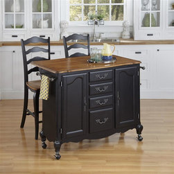 HomeStyles - Oak and Rubbed Black Kitchen Cart and Two Sto - The Kitchen Cart and Two Stools are constructed of hardwood solids and engineered wood in a distressed oak and heavily rubbed black finish. The distressed oak features several distressing techniques such as worm holes, fly specking, and small indentations. Cart features include two large cabinet doors with adjustable shelving, four storage drawers, two towel racks, and four casters (two locking). Design features include shaped carved proud legs, and detailed brass hardware. The drop leaf breakfast bar extends the depth by 29.75 inches. Bar stool features include metal foot rest. Seat height measures 24 inches high. Assembly required. Cart size: 44.5 in. W x 18.75 in. D x 36 in. H. Stool size: 18.75 in. W x 21.5 in. D x 46 in. H