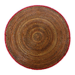 Calaisio - Round, Rattan Placemat with Red Beads - These hand woven placemats are created from a water vine that only grows in the mountainous areas of the South Pacific. Once reaped it grows back quickly, leaving no damage in these ecologically sensitive forests. They can be easily rinsed off because of the durability of the material. Each piece has a card attached, signed by the artisan that created it. It also lists the time it took for he or she to weave.