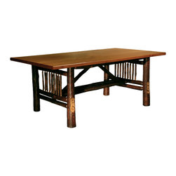 "Black Forest Hickory Craft Dining Table - Hickory logs and spindles create a traditional American feel  while a rich brown stain on the legs and a hickory top with a burntwood finish adds elegance to the Black Forest Hickory Craft Dining Table. Handcrafted in the USA from hand-harvested  eco-friendly hickory saplings with mortise and tenon joints. Seats up to six. Measures 76""W x 40""D x 30""H. ~ Ships from the manufacturer. Allow 4 to 6 weeks."