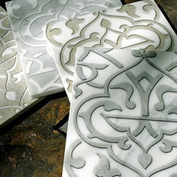 Stone Impressions - Stone Impressions Custom Murals & Accents - Stone Impressions' Charmed pattern in various colors on white Carrara marble tiles.