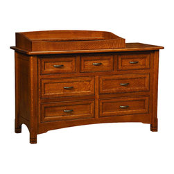 Chelsea Home Furniture - Chelsea Home Stratford 7-Drawer Dresser with Changing Table - For a nursery or bedroom in need of extra-Drawer space, the Stratford 7-Drawer Dresser, shown with Sap Cherry wood and Michaels Cherry low sheen stain, provides 3 small top drawers and 4 larger bottom drawers for your child's clothing and changing essentials. The decorative embellishment along the top edge of the dresser gives just the right amount of detail to the linear paneling of the dovetail drawers. Complete with full extension-Drawer slides, smooth metal hardware and premium finish, this piece is a sensible and traditional investment for any home. Remove the changing table when your child no longer needs it for added dresser top space. Changing table pad is also available for this item. Add this to your Stratford crib set to complete your child's bedroom! Chelsea Home Furniture proudly offers handcrafted American made heirloom quality furniture, custom made for you. What makes heirloom quality furniture? It's knowing how to turn a house into a home. It's clean lines, ingenuity and impeccable construction derived from solid woods, not veneers or printed finishes over composites or wood products _ the best nature has to offer. It's creating memories. It's ensuring the furniture you buy today will still be the same 100 years from now! Every piece of furniture in our collection is built by expert furniture artisans with a standard of superiority that is unmatched by mass-produced composite materials imported from Asia or produced domestically. This rare standard is evident through our use of the finest materials available, such as locally grown hardwoods of many varieties, and pine, which make our products durable and long lasting. Many pieces are signed by the craftsman that produces them, as these artisans are proud of the work they do! These American made pieces are built with mastery, using mortise-and-tenon joints that have been used by woodworkers for thousands of years. In addition, our craftsmen use tongue-in-groove construction, and screws instead of nails during assembly and dovetailing _both painstaking techniques that are hard to come by in today's marketplace. And with a wide array of stains available, you can create an original piece of furniture that not only matches your living space, but your personality. So adorn your home with a piece of furniture that will be future history, an investment that will last a lifetime.