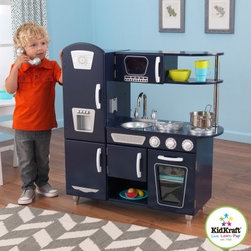 KidKraft Navy Vintage Play Kitchen - Order's up! The KidKraft Navy Vintage Play Kitchen is here to serve your child's imagination. This delightful set comes complete with fridge microwave stove oven and even the kitchen sink. For great interaction the doors swing open and shut and the knobs turn with a click. The set is finished in an alluring navy blue and has brilliant metal accents. Your child will be cooking up their favorite feasts in no time with this interactive set. About KidKraftKidKraft is a leading creator manufacturer and distributor of children's furniture toy gift and room accessory items. KidKraft's headquarters in Dallas Texas serves as the nerve center for the company's design operations and distribution networks. With the company mission emphasizing quality design dependability and competitive pricing KidKraft has consistently experienced double-digit growth. It's a name parents can trust for high-quality safe innovative children's toys and furniture.