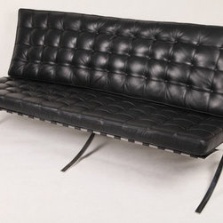 "IFN Modern - Barcelona Style Sofa - Aniline Leather, Black - Part of the famous Barcelona collection, our Barcelona Sofa reproduction was inspired by Mies Van Der Rohe's mid-century furniture. The main source of inspiration for this piece comes from the 1929 German Pavilion where Mies and Lilly Reich showcased a gorgeous chair now known worldwide as the Barcelona Chair.                                                                                                        Overall Dimensions - 31.5""H x 71""W x 29.5""D"