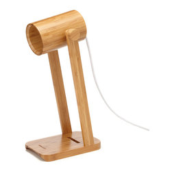 Geek Supply Co. - Watchman Bamboo Desk Lamp - Beautiful,100% bamboo gets a mid-century modern polish in this stately table lamp. Smooth slats of wood are sanded and sealed to best display the wood's intricate grain. A streamlined lampshade can be positioned at just the right angle for late-night reading or detail work at your desk, and a little opening at the base of the light can be threaded with a USB or phone charger wire.