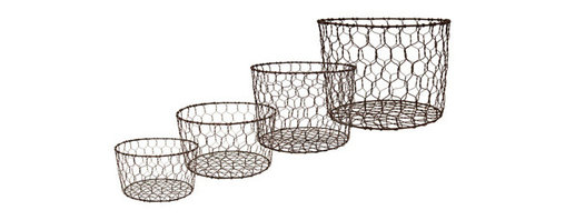 Wire Baskets - Set of Four - With airy twisted construction and a signature rust patina, the Granada wire baskets offer versatility to the home decorator: a designer storage solution for those objects that don't tidy away anywhere else, or purely decorative containers with an unmistakable rustic appearance that allow the contents to be seen. In graduated sizes, these unusual baskets offer the freedom to arrange and rearrange the quartet into casual collections or thoughtful vignettes.