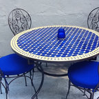 "Moroccan Outdoor - This beautiful blue and yellow 48"" Moroccan mosaic table goes great with the four Bistro curly style, wrought iron chairs, and makes for a great outdoor dining set. These Moroccan tables that burst with color will compliment anyone's backyard."