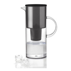 "Stelton - Stelton E. Magnussens Water Jug with Filter, 68 oz - Smoke - Water Jug with compartment for water filterThe new jug gives you crisp clean water with reduced carbonate hardness and impurities. Able to use Brita or Mavea water filters. Capacity: 2 quart / 67 oz (2 liter). Material: Materials: Plastic, FDA approved. Dimensions: 11"" high x 4.40"" diameter (27,5 x 11 cm). Designed by Erik Magnussen, 2012. Made in Denmark."