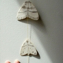 Moths Paper and Wax String Mobile by Amy Ruppel - I love this mobile from Amy Ruppel. It's so sweet and lovely and would make a pretty little accent for a lonely wall or corner.