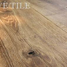 Traditional Hardwood Flooring by Pavé Tile, Wood & Stone, Inc.