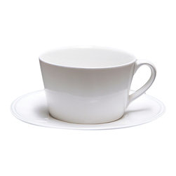 Clos du Manoir Large Teacup and Server - Express an appreciation for cultured tableware by keeping the breakfast nook set for tea with the Clos du Manoir Large Teacup and Saucer. The unusual oval shapes of the Clos du Manoir collection match your most practical white serveware while maintaining a distinctive look, and these large-sized additions to your china are perfectly-sized for either soothing tea or invigorating coffee.