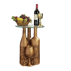 "EttansPalace - Wine and Dine Sculptural Glass-Topped Table - Each days a celebration of good wine and good friends with this charmingly nostalgic table, literally set atop favorite vintages of the past! A trio of oversized wine bottles gathers with grapes and stemware to host your next tasting and to be showcased to full advantage beneath a 16""-diameter, 3/8""-thick glass top. Cast in quality designer resin, our exclusive table is finished in faux bronze to bring out each vintage detail."