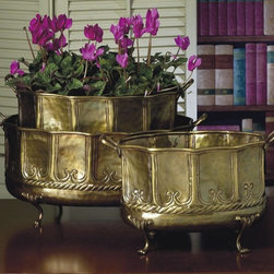"Dessau Home - 3 Pc Embossed Footed Planters Set - Includes small, medium and large. Made from brass. Small: 11 in. W. Medium: 13 in. W. Large: 15 in. WValue has always been an essential ingredient at Dessau Home. ""Essentials"" represents a collection of well-appointed yet affordable home furnishings with a unique traditional styling that appeals to most transitional and contemporary home decorating needs."