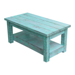 Rustic Coffee Table with Shelf - This beautiful coffee table has been made from reclaimed wood and measures 42L x 22W x 17.5H and has been stained and painted for utmost protection. This piece is even more beautiful in person as it has so much rustic detail. The color is original and cannot be reproduced. I call it muted aqua. It's bright enough to bring life to your space but not so bright that it takes over. It's the perfect blend of neutral and pop. Remember these are each made by hand so no two pieces will ever be exactly alike.