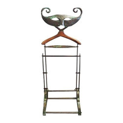 Used Copper Venetian Mask Clothes Valet - Add playful design to your dressing routine. Sculptural hammered copper Venetian mask clothes valet. The copper has a rich patina with verdigris accents. A copper tray is beneath the wood hanger, while the base is clad in copper.