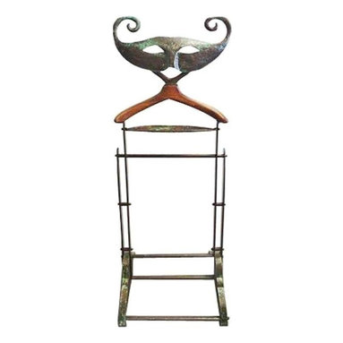 Pre-owned Copper Venetian Mask Clothes Valet - Add playful design to your dressing routine. Sculptural hammered copper Venetian mask clothes valet. The copper has a rich patina with verdigris accents. A copper tray is beneath the wood hanger, while the base is clad in copper.