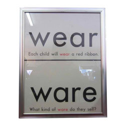 Educational Graphic - Wear - Ware: 1960's era educational graphics - Homophones - are a lot of fun. Framed in a minimal brushed metal finish with glass, these nostalgic grammar school teaching aids look great hung individually or in groups.