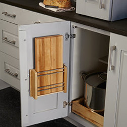 Door Storage Cutting Board Rack - This cutting board (included) hangs on the inside of a cabinet for easy access.