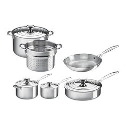Le Creuset - Le Creuset 10 Piece Tri-Ply Stainless Steel Set - SSP14110 - Shop for Cookware Sets from Hayneedle.com! Be prepared for anything with the Le Creuset 10 Piece Tri-Ply Stainless Steel Set. Complete with an eight-inch nonstick fry pan 10-inch fry pan 2-quart saucepan with lid four-quart saucepan with lid 9-quart stockpot with lid and a deep colander insert for the stockpot you ll have everything you need for cooking at your fingertips. Crafted from durable tri-ply stainless steel each pan in this set has a full aluminum core protected by the rolled sealed and polished rim which heats quickly and evenly as well as a magnetic external layer which is induction-compatible and infused with titanium to resist discoloration. The non-stick fry pan features durable nonstick coating which provides for superior reliable food release while the other pieces are made of surgical-grade stainless steel which allows the interior of each pan to provide a safe and stable cooking surface while the proprietary steel blend of the pan resists pitting and scorching and maintains its luster over time. Featuring ergonomic handles for easy maneuvering these pans also have a precision-pour rim which allows for clean easy pouring straight from the pan. The saucepan lid has a relief vent to release steam and prevent boil-over while the laser etched interior capacity makes measuring easy. Retain moisture and keep your food warm in the stockpot with the included lid. Use the deep colander insert with your stockpot to make draining pasta and vegetable a cinch. Each piece is oven safe up to 500 degrees Fahrenheit (nonstick pan safe up to 425 degrees Fahrenheit) and is safe for gas electric ceramic halogen and induction stovetops. Additional Features Deep colander insert for stockpot Lids for saucepans saute pan and stockpot Magnetic external layer is induction-compatible Exterior is infused with titanium to resist discoloration Inside layer made of surgical-grade stainless steel Provides a