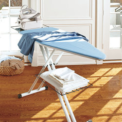 "Frontgate - Deluxe Ironing Board with Iron Holder - Tube frame construction for maximum rigidity and stability. Double wishbone legs eliminate wobbliness. Lead-free, high coat white finish. Ergonomically correct iron tray is permanently riveted to the board's underside. Height adjusts from 30"" to 38"". Our lightweight Deluxe Ironing Board with Iron Holder is the pinnacle of ironing board excellence. Handmade in Italy by skilled craftsmen, this board is designed to provide maximum stability, with features such as an extra large pressing surface and a laundry rack to make ironing less work. The superior pad set is made with a full 500g felt padding and a polyester cotton cover.  .  .  .  .  ."