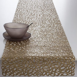 Chilewich - Pebble Table Runner by Chilewich - Inspired by the organic shapes of stones on a beach. The Chilewich Pebble Table Runner is an original molded vinyl design that reimagines and reinterprets these shapes, making them an accessible aesthetic for your table top. The runner's intricate, beautiful pattern is available in several different colors and is easily cleanable with soap and water. Suitable for indoor and outdoor use. For over a decade, New York based designer Sandy Chilewich has been creating original and innovative vinyl products for the home. Her woven, tufted, molded and spun textiles are available in a range of vibrant and neutral hues that have become synonymous with the Chilewich brand name.