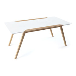 Modern Classic Table - Let this sleek and simple table class up your dining area with its easygoing presence. Featuring elegant, angled legs and a smooth, white tabletop, it should slip into your room without making a peep.