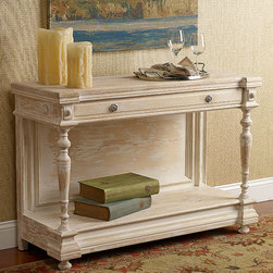 The Saved Hall Console - In a fresh twist on tradition, our light, airy console takes classic Jacobean and Empire elements - like carved moldings, turned legs and a substantial base shelf - and gives them functional appeal with a streamlined silhouette and a weathered whitewash finish. Crafted of pine, with a single drawer and storage/display area below, it brings casual elegance to an entry, dining room or floating behind a sofa.