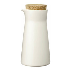 Iittala - Teema Milkjar White - Whether you are making your own almond milk or just like a chic alternative to the standard plastic jug, you will love this ceramic carafe. The cork lid keeps contents fresh, and the modern design instantly elevates your morning cereal. When you've poured the last drop, simply place it in the dishwasher for easy cleanup.