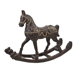 Used Antique Wood and Brass Rocking Horse - When it comes to high style, this piece is first in show. Stunning wood rocking horse, with intricate hand-carved details and brass tacks.
