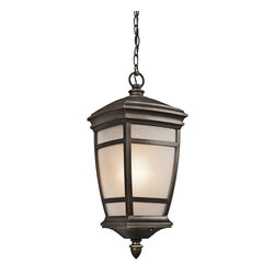 Kichler 1-Light Outdoor Fixture - Rubbed Bronze Exterior - One Light Outdoor Fixture. This lighting outdoor hanging pendant light features a warm toned rubbed bronze finish that accentuates the tapered shape and traditional flair. An elegant light umber etched seedy glass shade pulls the look together. Energy efficient compact fluorescent lamp may be used: not included.