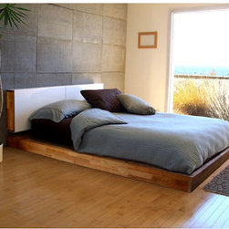"Mash Studios - LAX Series Queen Platform Bed with Headboard - LAX Series Queen Platform Bed with Headboard  by MASHstudios    At A Glance:   Get in on the ground floor with this beautiful low platform bed. It's perfect for those larger rooms, or rooms with high ceilings; a low platform bed heightens the drama of architectural extremes. Included headboard mounts to the wall and features attractive sliding white powder-coated aluminum doors that conceal two interior shelves. Finished in solid oiled English Walnut, with a king-size version also available.  What's To Like:   We love on-the-floor beds; they add a modern, minimalist touch to any bedroom, and the LAX Platform Bed is one of our favorites for its strict, no-frills minimalism. But minimalist doesn't mean ""heartless,"" does it. Warm wood and rich oil finish bring a very natural, homey feel to this platform bed. The headboard does just what we wish our headboards did - eliminates the need for clutter-y nightstands by replacing them altogether"