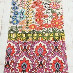 Floral Stripe Printed Rug - I love the riotous combination of colors and patterns in this mat. It would look great in a teen girl's room or as a hall runner in an eclectic home.