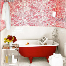 eclectic bathroom apartment therapy- red clawfoot tub