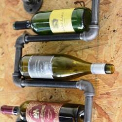 Down the Pipeline - Recommended to screw into wall studs.  Includes screws. Light assembly may be required to reduce cost of shipping.  6 bottle wine rack available for $80.00.