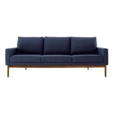 Design Within Reach - Raleigh Sofa   Design Within Reach - Raleigh (2009) is a comfortable, modern collection that draws from mid-century Danish design. Wrapping around the back of this Sofa is a solid walnut frame (be sure to click on Additional Views to see it) that brings visual lightness and satisfying aesthetic tension to the design. There's also a very functional reason for the way that this frame triangulates to the back of the Sofa. Namely, that it permits a gracefully canted and ergonomic seatback while still solidly supporting you as you relax and unwind. DWR Design Studio chose to work with Jeffrey Bernett and Nicholas Dodziuk on this project because of the importance they place on people – how they move, interact, live, and most of all, sit. Made in U.S.A. Best of Year! The Raleigh Collection received Interior Design magazine's top honor for 2010 in the residential lounge category. The angled, high back comfortably supports your upper body. Visible from the side and back, this Sofa is cradled in a solid walnut frame. Down-blend filled back cushions have removable covers for cleaning. DWR Exclusive.