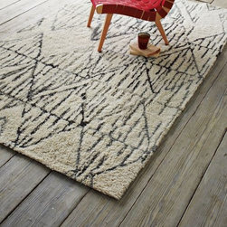 Snow Peak Rug - This rug looks so soft and cozy. The color and pattern work to create a really calming place that makes you just want to sit down and have a cup of tea. It's an understated piece that would fit into any room beautifully