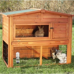 "Trixie - Rabbit Hutch with Attic - Rabbit Hutch with Peaked Roof is ideal for small animals such as rabbits and guinea pigs. The two story design has a retreat area on the upper level. The non-slip ramp allows your pets to roam inside and outside, upstairs and downstairs, in the sun or in the shade for ideal comfort. Features: -Materials: Glazed pine (non-toxic DIN-EN71 Standards), close-meshed galvanized grid, composite asphalt shingles, metal. -Wood paneling at the back offers additional protection from the elements.. -For easy maintenance, we've included a pull-out plastic tray and a hinged roof with locking arm that can be opened from above.. -Solid wood construction, glazed pine finish, and the finest materials means this hutch will endure years of use with very little maintenance.. -Note: Water bottle and bowl not included.. Specifications: -Medium dimensions: 47"" H x 38"" W x 31"" D - (70 lbs). -X-Large dimensions: 45"" H x 53"" W x 44"" D - (110 lbs)."