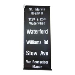 Upstate New  York II - Circa 1970's, this Vintage Transit Route Sign was put into service on a bus or trolley car in Upstate New York. Each line on the black & white graphic banner indicated a stop on the mass transit route. The mylar material this graphic sign was printed on helps date it to the 1970's - prior to this mylar material, similar signs were printed on fabric.