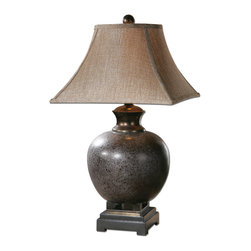 Villaga Distressed Table Lamp - Mottled, Rust Brown Glaze With Black Accents And Dark Bronze Details. The Round Top, Square Bottom Bell Shade Is A Taupe Linen Fabric With Black Striations. Number Of Lights: 1, Shade: Round Top, Square Bottom Bell, Shade Size: Height: 12, Top: 9w X 9d, Bottom: 16w X 16d, Voltage: 110, Wattage: 150w, Bulbs Included: No