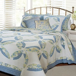 Greenland Home Fashions Francesca Bonus Quilt Set - If you're not a quilting aficionado, then you need to know that the interlocking ring pattern on the Greenland Home Fashions Francesca Bonus Quilt Set is actually called a wedding ring, and it's a traditional quilting pattern. You'll want to sound like a pro, because people will believe you really know your stuff when you outfit your bed with this complete set. Sporting a classic design, the quilt is made with a high-quality 100% cotton face, stitching, and fill. The quilt's reverse side has a coordinating, all-over paisley pattern that allows you to choose between two distinctly different looks. Machine-quilting adds durability, while the oversized shape gives the greater coverage you need for today's deeper mattresses. Along with the quilt, you'll receive a pair of coordinating decorative pillows and one or two shams, depending on the size you order. Each piece is pre-washed, pre-shrunk, and machine-washable.Product Dimensions:Twin comforter: 88L x 68W in. Full/queen comforter: 90L x 90W in.King comforter: 95L x 105W in.Small sham: 20L x 26W in.Large sham: 20L x 36W in.Decorative pillow: 16W x 16L in.About Greenland Home FashionsFor the past 16 years, Greenland Home Fashions has been perfecting its own approach to textile fashions. Through constant developments and updates - in traditional, country, and more modern styles – the company has become a leading supplier and designer of decorative bedding to retailers nationwide. If you're looking for high-quality bedding that not only looks great but is crafted to last, consider Greenland.