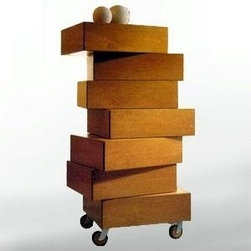 Italydesign Studios - Morgana Tallboy Dresser - A chest of 7 Wenge stained oak drawers that is characterized by a special joint that enables each drawer to be able to rotate 360 degrees to take up highly original configurations that can be varied according to mood. Stack straight or angled.