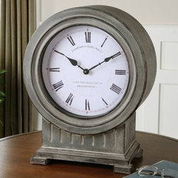 Uttermost Chouteau Mantel Clock - 18.6H in. - The Uttermost Chouteau Floor Clock exudes old European sophistication. The clock, made of metal and engineered wood, comes with an antiqued, dusty gray finish, burnished edges, and an Old World persona for your fireplace mantel or the top of a desk or table. The weathered clock face has Roman numerals and a vintage typeface, giving a nod to its yesteryear inspirations. The Uttermost Chouteau Mantel Clock shows a simplicity with understated vertical carvings beneath the large clock face. It keeps reliable and accurate time with quartz movement, the most widely used form of time keeping around the world.A coordinating floor clock is also available.About UttermostThe mission of the Uttermost Company is simple: to make great home accessories at reasonable prices. This has been their objective since founding their family-owned business over 30 years ago. Uttermost manufactures mirrors, art, metal wall art, lamps, accessories, clocks, and lighting fixtures in its Rocky Mount, Virginia, factories. They provide quality furnishings throughout the world from their state-of-the-art distribution center located on the West Coast of the United States.