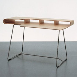 Cappellini Loop Desk By Barber Osgerby - I'm a sucker for designs that mix metal and wood. The key is to get the ratio just right. This light and elegant modern desk almost appears to float, and you can fit it into a home office where you're tight on space.