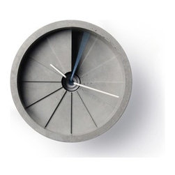 """22 DESIGN STUDIO - 4th Dimension Concrete  Clock - The weighty 4th Dimension wall clock stands out thanks to its unusual material: concrete. Created by the Taiwanese industrial design firm 22designstudio, the three-pound clock resembles a circular staircase with each hour represented by a miniature triangular step. Investigating concrete due to its wide-availability as well as it's low cost, the designers have explored the way in which different processes of production can create stunning effects. The concept of linking time and space is visualized through the spiral form and the interaction with the hands which continuously circle around as time goes by; thus the """"4th"""" dimension. Light and shadow also interact, providing for delightful results."""